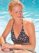 Woman in Pool prepares for Mastopexy